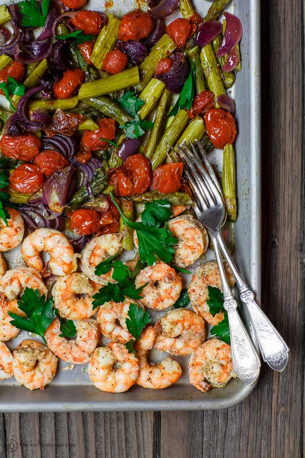 Mediterranean Sheet Pan Shrimp and Veggies | The Mediterranean Dish. Easy, quick baked shrimp with veggies, all dressed in a Mediterranean citrus-ginger sauce. Ready in 25 minutes! From TheMediterraneanDish.com #shrimp #mediterranean #mediterraneandiet #easyrecipe #onepanmeal #sheetpandinner #seafood #healthyrecipes #whole30 #glutenfree