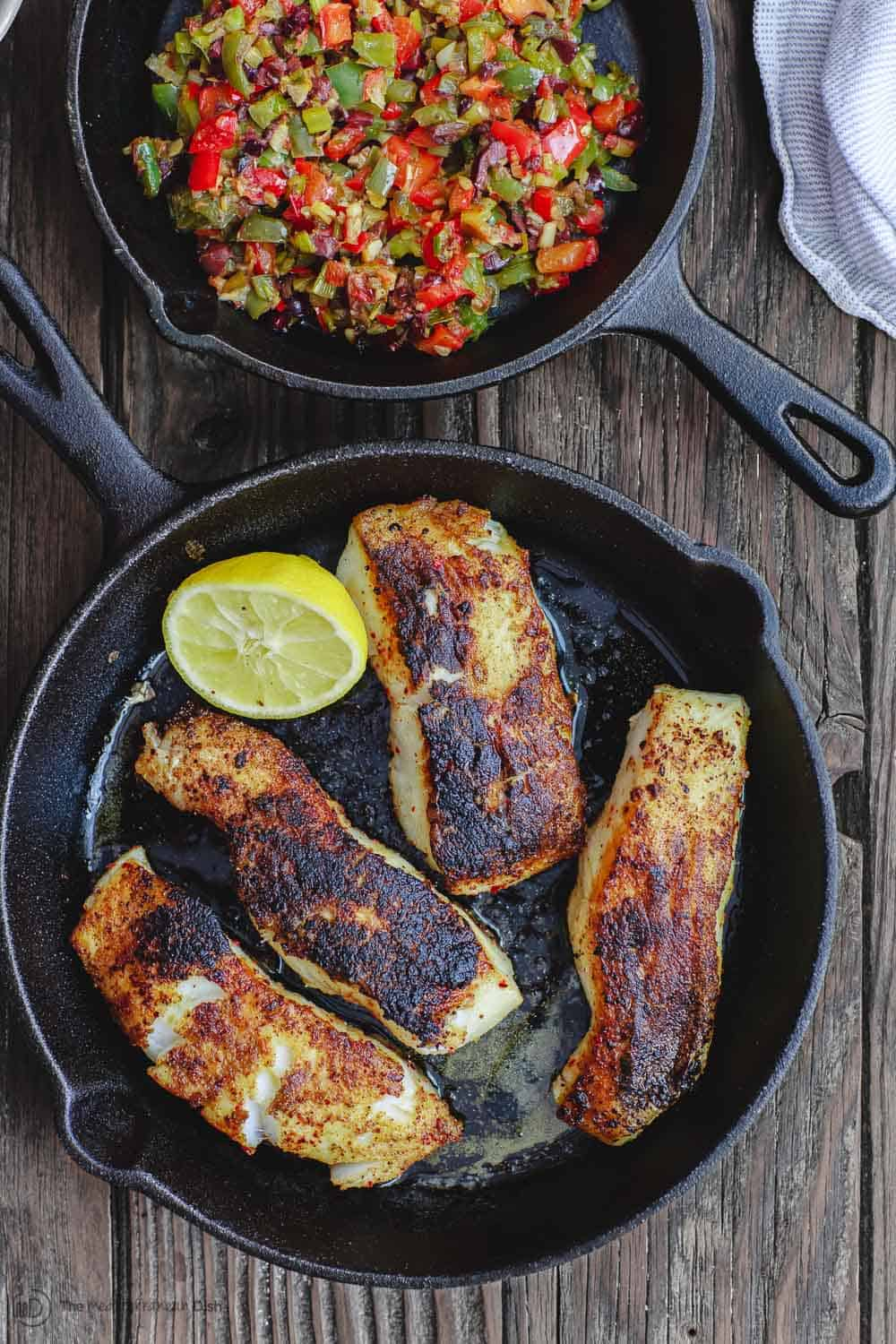 Pan seared sea bass in a skillet