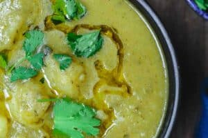 Vegan Potato Leek Soup | The Mediterranean Dish. Warm, rustic vegan potato leek soup, prepared Mediterranean style with garlic, cilantro (or other fresh herbs), and great spices! Not your average potato leek soup! on TheMediterraneanDish.com #soup #veganfood #potatosoup #potatoleeksoup #veganrecipes #glutenfreesoup #glutenfreefood #glutenfreelife #mediterraneanfood #mediterraneandiet #mediterraneanrecipes #onepotdinner #easyrecipes