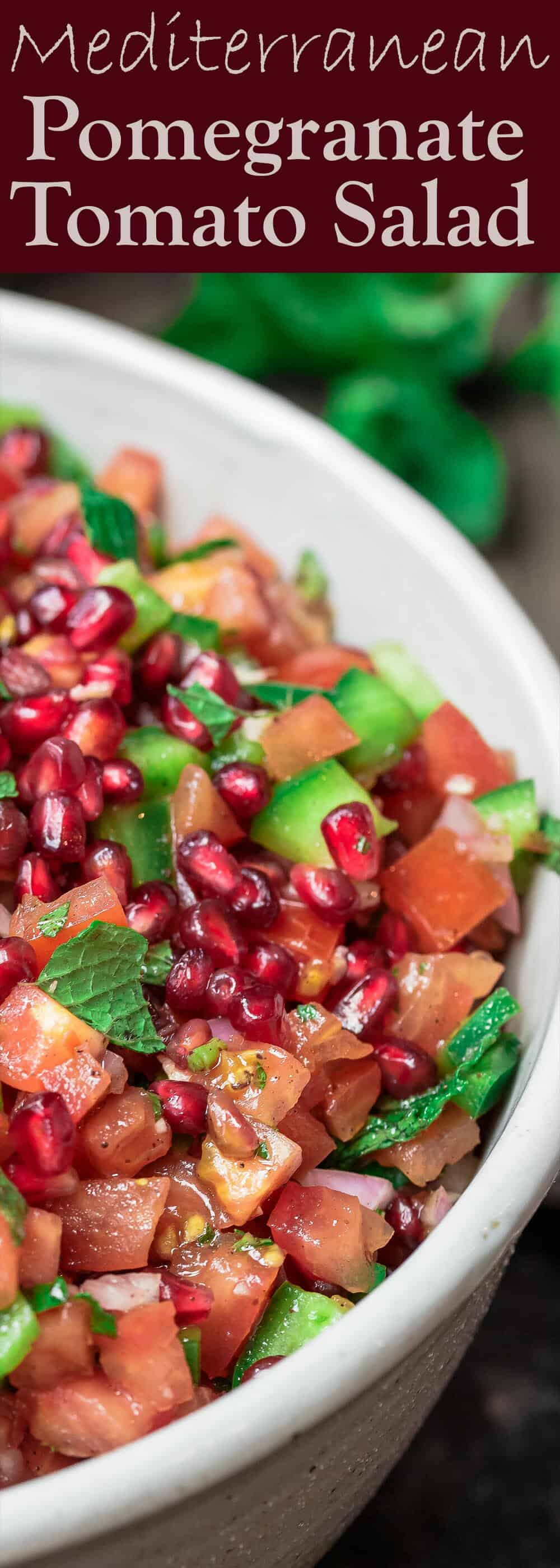 Mediterranean Pomegranate Tomato Salad | The Mediterranean Dish. This Mediterranean salad uses so few ingredients. So bright and flavor-packed! Tangy pomegranates and sunny sweet tomatoes are the perfect combination, with fresh mint and shallots! And the dressing is amazing! From TheMediterraneanDish.com