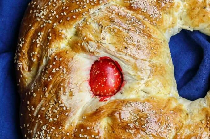 Greek Easter Bread Recipe | The Mediterranean Dish. Easy Easter bread recipe for sweet, brioche-like Easter bread with a Greek twist. Tasty, dense bread that's adorned with red eggs. Recipe from TheMediterraneanDish.com #bread #baking #easterbread #easterrecipes #mediterranean #greekfood #greekrecipe
