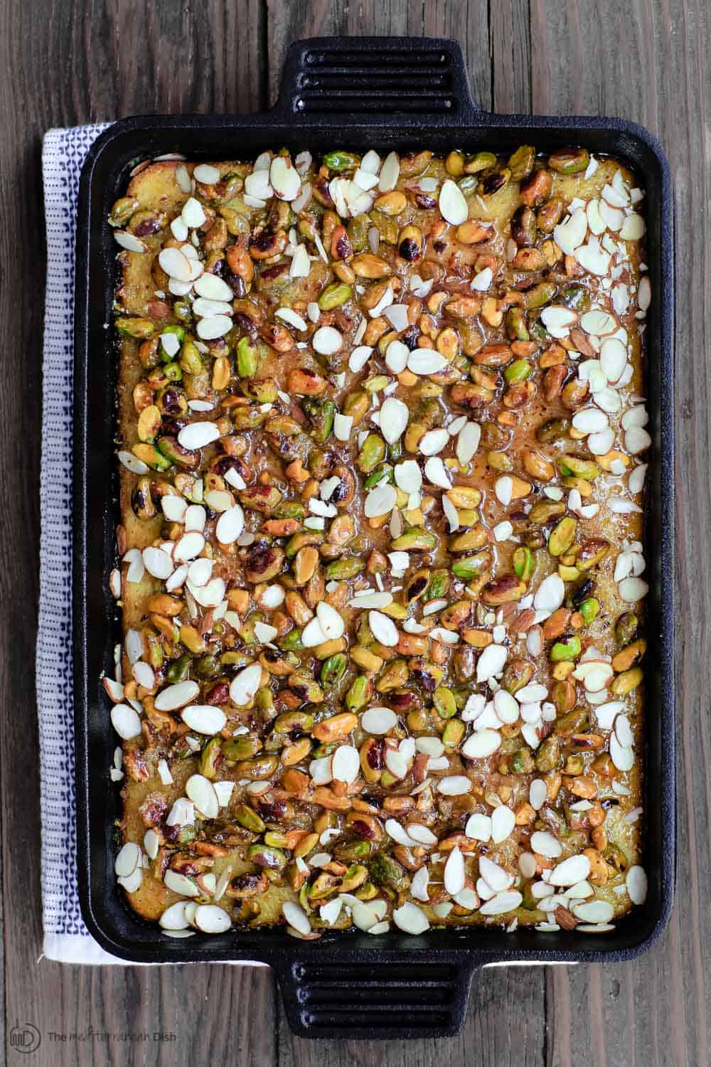 Greek Honey Cake in large pan. Topped with pistachios and slivered almonds
