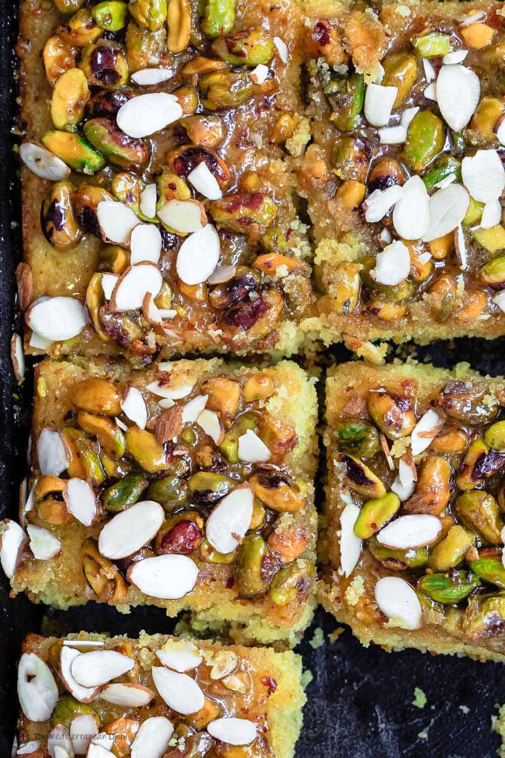 Greek Honey Orange Cake with pistachios and almonds. Sliced for 15 people