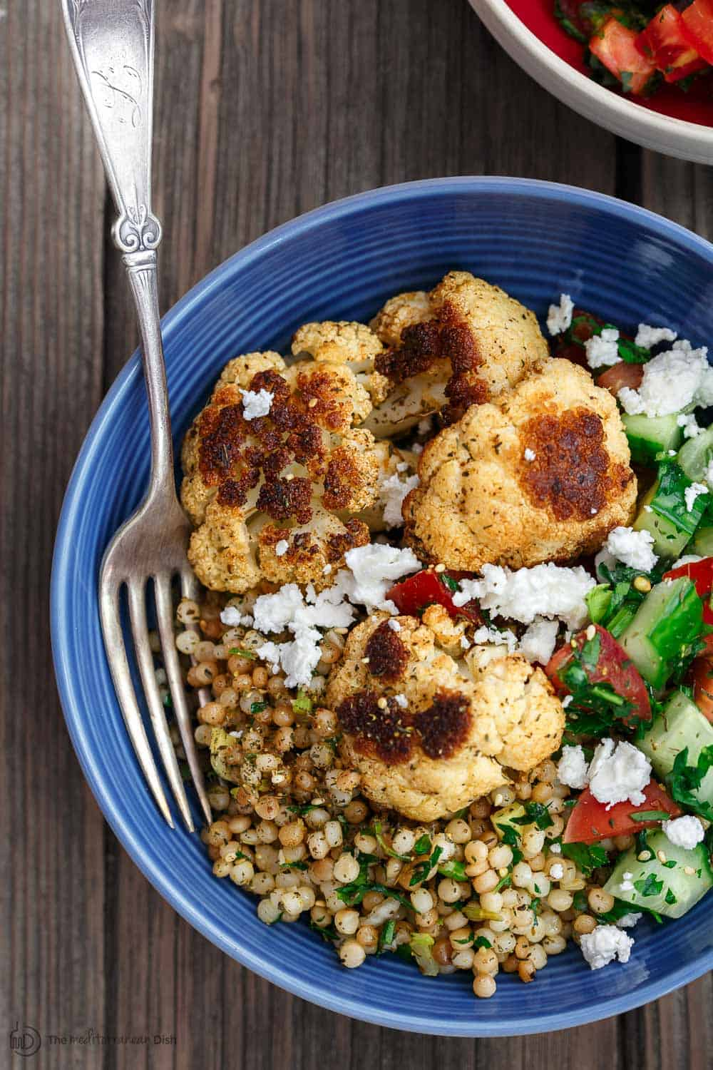Bowl of Roasted Cauliflower and couscous with vegetables