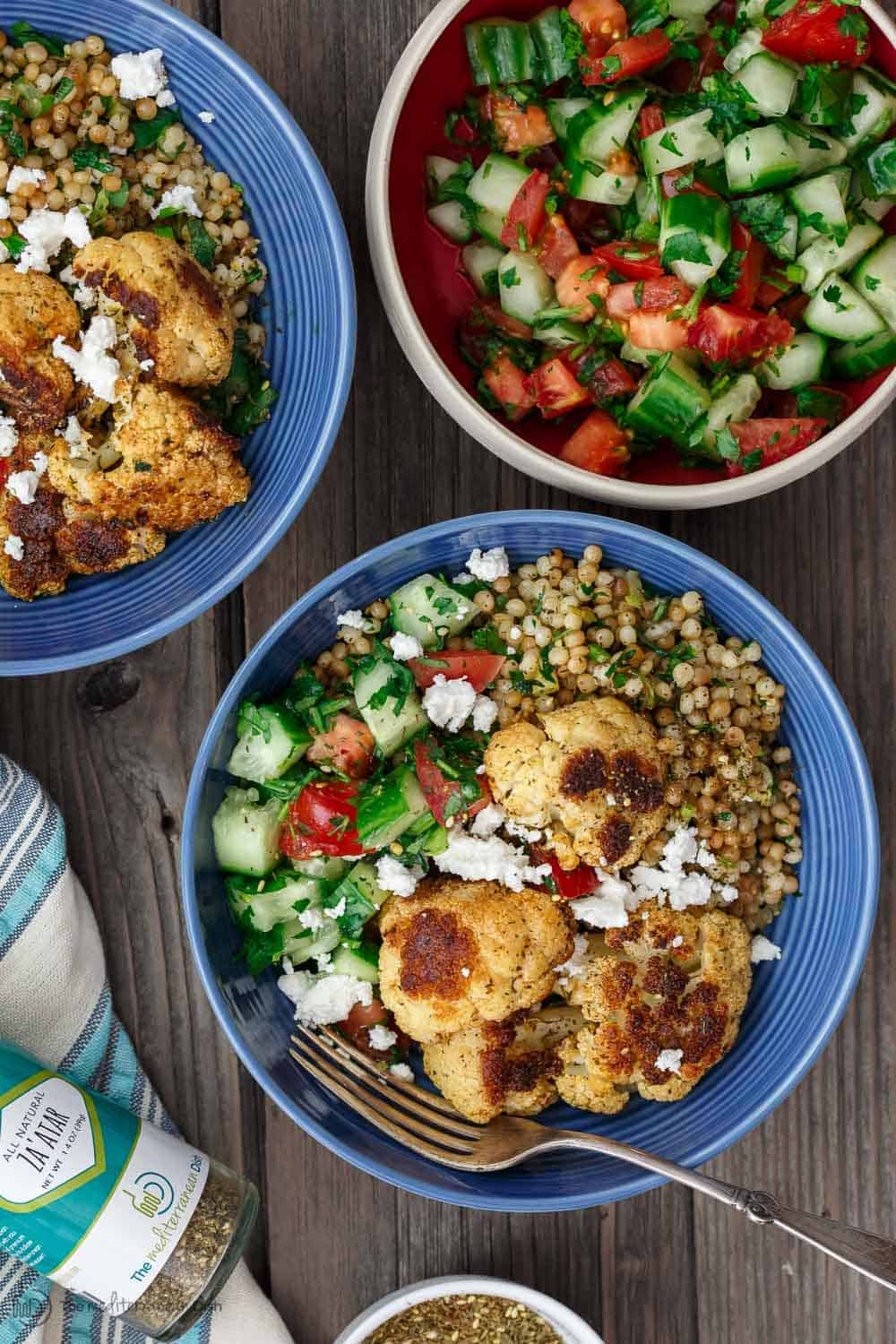 Herbed Couscous and cauliflower served with a cucumber and tomato salad