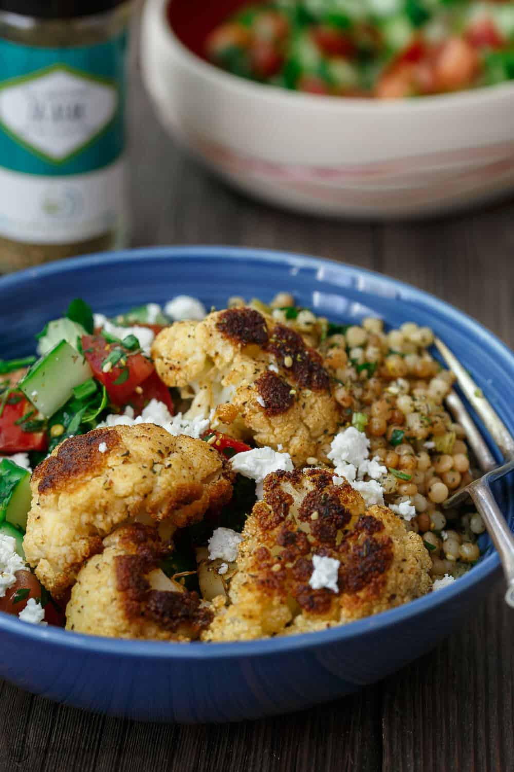 Bowl of Couscous and Roasted Cauliflower garnished with feta cheese