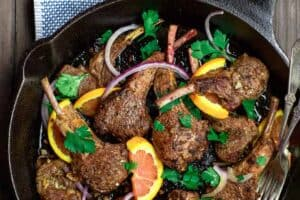 Orange Harissa Lamb Chops Recipe | The Mediterranean Dish. Quick pan-seared and flavor-packed lamb chops with a special Mediterranean spice rub and an orange-garlic marinade. So little work goes into these lamb chops, but they are the BEST! See them on TheMediterraneanDish.com #lamb #lambchops #Mediterraneanfood #moroccanfood #easyrecipe #onepan #onpot #mediterraneandiet #meat