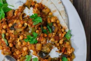 Greek Style Braised Eggplant Recipe | The Mediterranean Dish.All star braised eggplant recipe, prepared Greek style! Eggplants cooked to velvety tender perfection with chickpeas and tomato with aromatics and a few awesome spices. A perfectly satisfying meatless dinner or side dish. Vegan. Gluten Free. #meatless #eggplantrecipe #chickpearecipe #mediterraneandiet #greekfood #veganrecipe #glutenfreerecipe #chickpeas #eggplant #meatlessdinner #onepot #easyrecipes #healthyrecipe #vegetarian