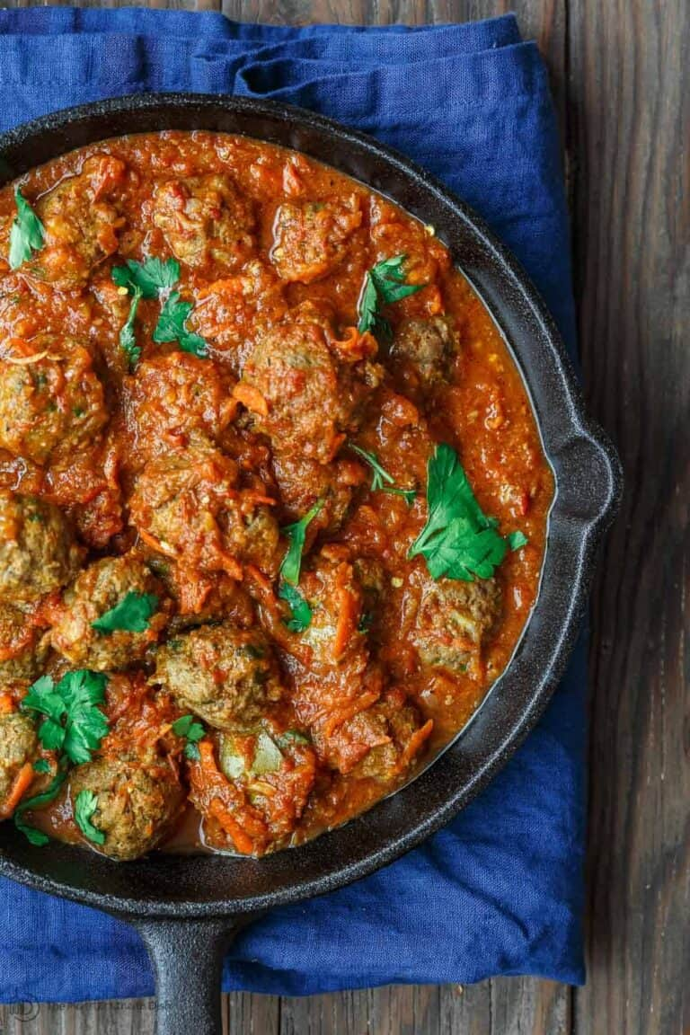 Lebanese-Style Meatballs Recipe in Tomato Sauce   The Mediterranean Dish. Juicy, tender meatballs, prepared Lebanese-style with notes of cinnamon and allspice, then braised in a tasty, thick tomato sauce. A couple simple ingredients take this meatballs recipe over the top. From TheMediterraneanDish.com #easyrecipe #meatballs #mediterraneanrecipe #mediterraneandiet #lebanese #meatballsrecipe #onepot