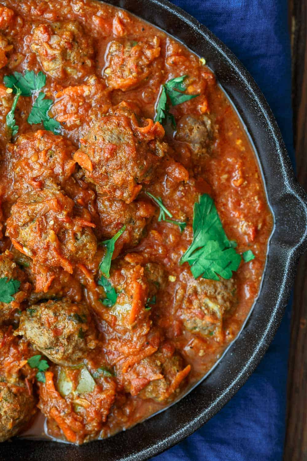 Close-up of tomato sauce with Lebanese Meatballs in a skillet