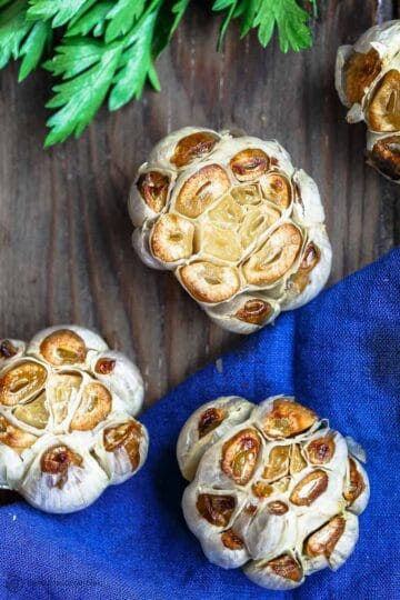 How to Roast Garlic and How to Store It | The Mediterranean Dish. Learn a few simple ways to roast garlic and to store your roasted garlic for daily use. These roasted garlic recipes are foolproof and give you the best soft, caramelized, and smoky roasted garlic. Plus get our recipes using roasted garlic. from themediterraneandish.com #garlic #roastedgarlic #mediterraneandiet #greekrecipes #italianrecipes #greekfood #italianfood #mediterraneanrecipes