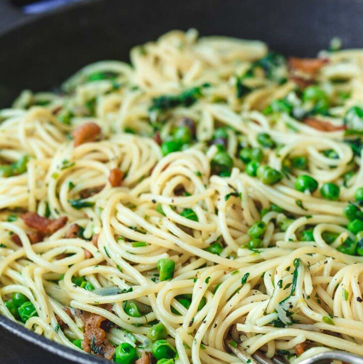 pancetta pasta with peas in a cast iron skillet