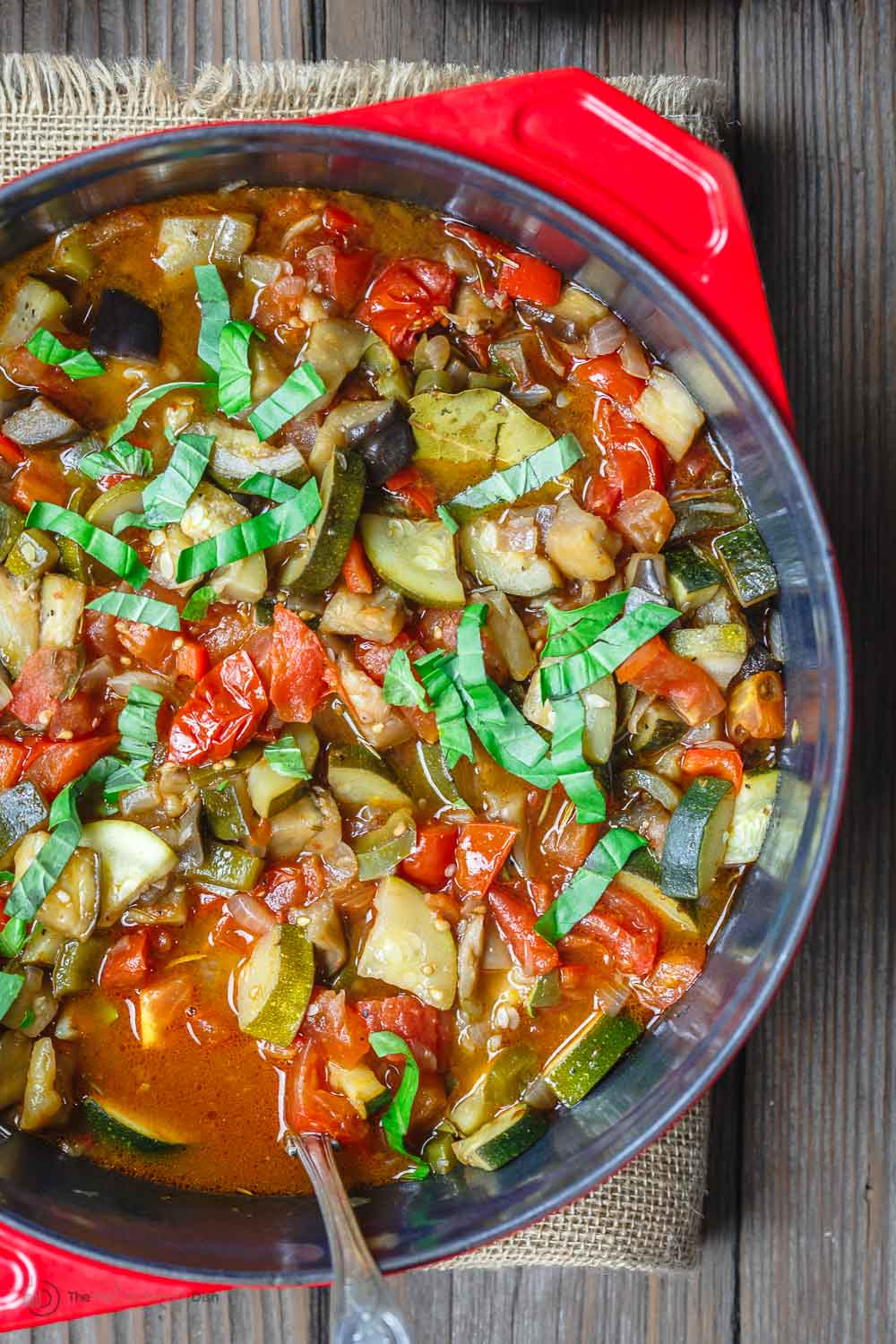 Easy Ratatouille Recipe | The Mediterranean Dish. A simple, hearty, and flavor packed ratatouille made in just one pot. Recipe comes with tips for best ratatouille, how to serve ratatouille and more. The perfect weeknight meal from themediterraneandish.com. #ratatouille #easyrecipe #mediterraneandiet #mediterraneanrecipe #vegan #veganrecipes #vegetarian #vegetarianrecipes #stew #zucchinirecipes #eggplantrecipes #glutenfree #glutenfreerecipes