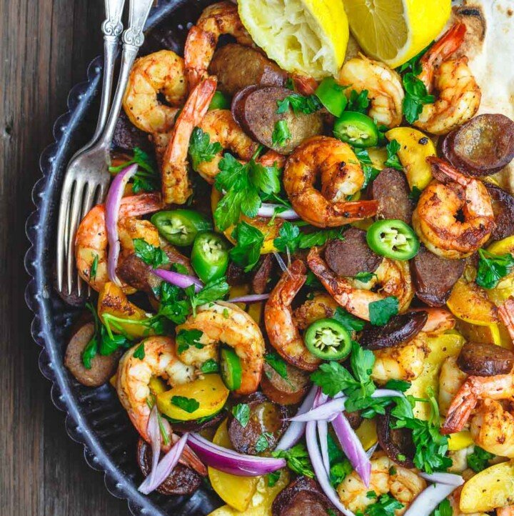 Skillet Shrimp Recipe with Chorizo and Squash | The Mediterranean Dish. Easy recipe for Spanish inspired skillet shrimp with flavors like smoked paprika and cumin. We add Spanish Chorizo and summer squash to complete the feast! Cooks in 20 minutes! From TheMediterraneanDish.com
