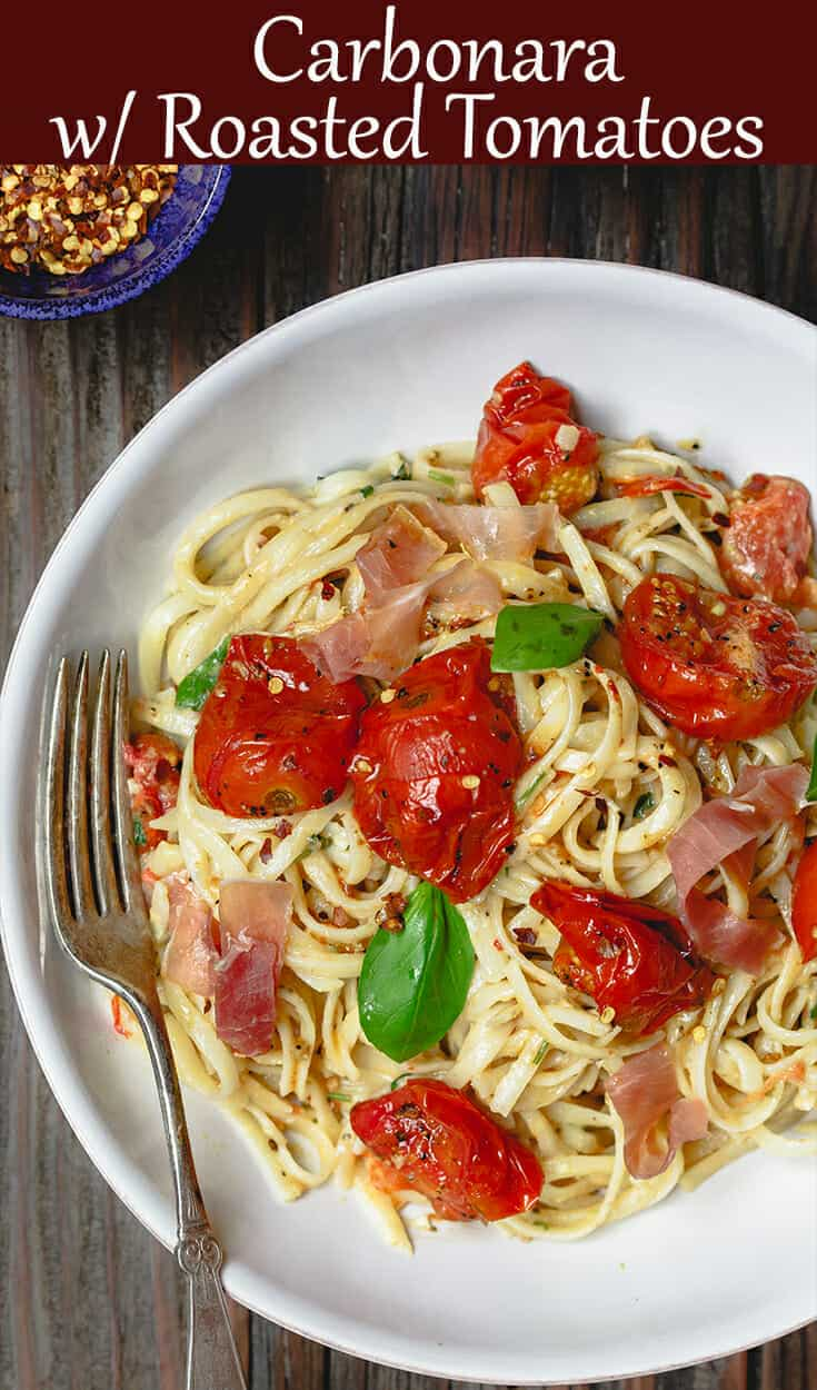 Carbonara Recipe with Roasted Tomatoes   The Mediterranean Dish. A lighter, and flavor-packed cabornara recipes with garlic roasted tomatoes and fresh herbs. You can add ribbons of prosciutto, if you like. A couple of tricks make a perfectly creamy carbonara. Recipe from themediterraneandish.com #pasta #pastarecipe #italianfood #mediterraneandiet #carbonara #easyrecipe