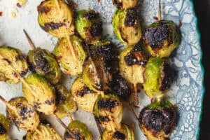 Grilled Brussels Sprouts Skewers   The Mediterranean Dish. Easy, flavor-packed burssels sprouts. Marinated, Mediterranean style, then charred to perfection and finished with Parmesan cheese. Recipe from themediterraneandish.com
