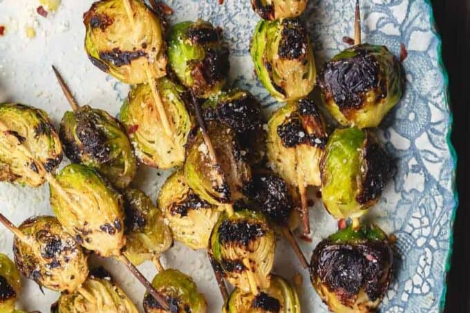 Grilled Brussels Sprouts Skewers | The Mediterranean Dish. Easy, flavor-packed burssels sprouts. Marinated, Mediterranean style, then charred to perfection and finished with Parmesan cheese. Recipe from themediterraneandish.com