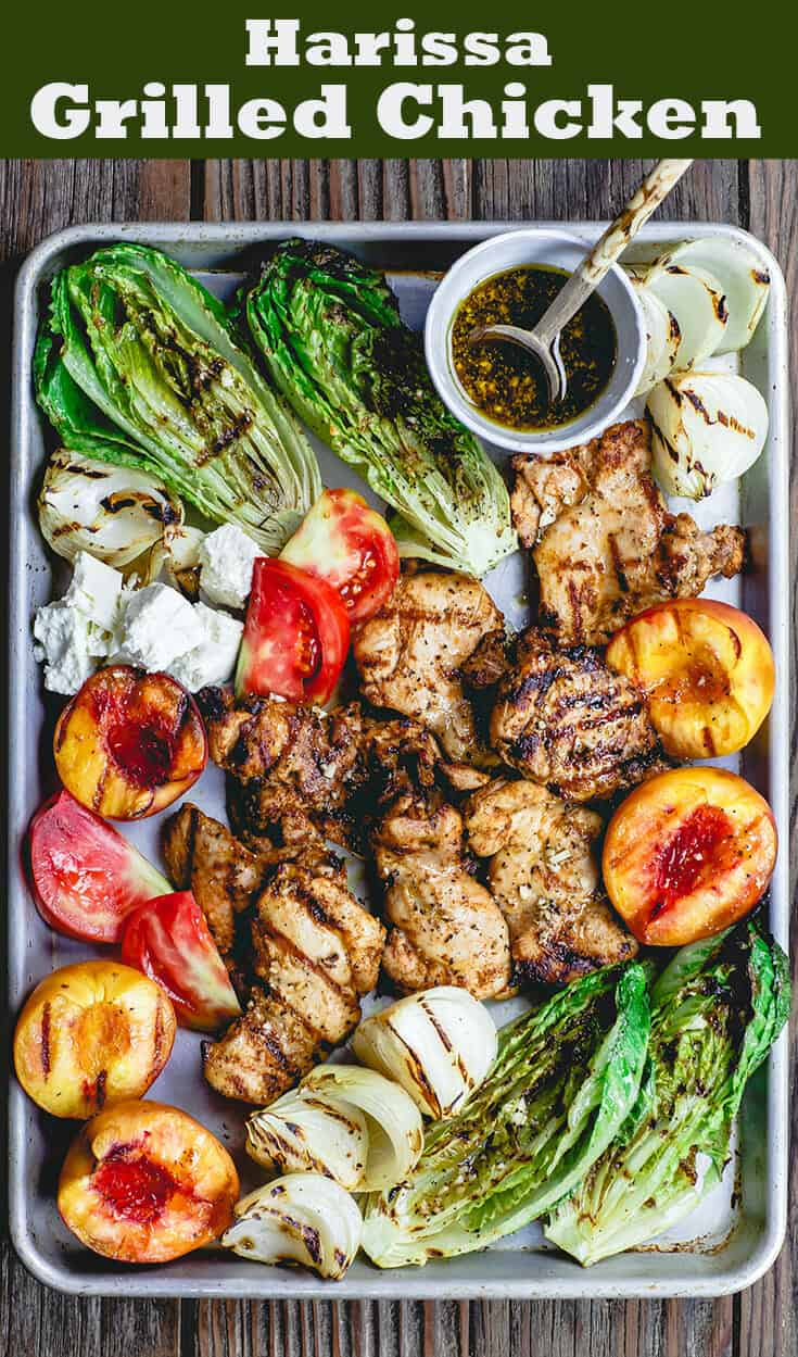 Grilled Harissa Chicken Recipe | The Mediterranean Dish. Easy, flavor-packed Mediterranean grilled chicken. Add grilled vegetables and peaches or serve with your favorite salad. Get the recipe on themediterraneandish.com #grilledchicken #mediterraneanchicken #mediterraneandiet #easydinner #heatlhyrecipes #grilledpeaches #grilledlettuce