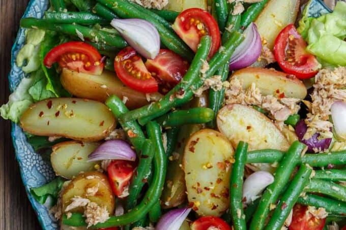 Spanish Potato Salad Recipe with Tuna | The Mediterranean Dish. Easy, tasty potato salad with tuna, green beans, and tomatoes. Lots of flavor from earthy spices and a simple Spanish-inspired dressing. Great as an appetizer or a light dinner. Recipe from TheMediterraneanDish.com #mediterraneandiet #mediterraneansalad #spanishsalad #potatosalad #glutenfree #tunasalad #healthyrecipes #greenbeans