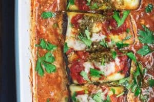 Eggplant Rollatini Recipe | The Mediterranean Dish. Flavor-packed, healthy eggplant rollatini that is perfect for dinner or as an appetizer. The secret is in the tasty rollatini filling with part-skim ricotta, basil pesto, and fresh parsley. Recipe from themediterraneandish.com #eggplant #mediterraneanfood #mediterraneandiet #italianfood #eggplantrollatini #glutenfreerecipes