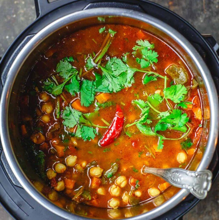 Easy Chickpea Instant Pot Soup | The Mediterranean Dish. Mediterranean style chickpea soup, with vegetables, fresh herbs, and great spices. You can make this in minutes in the Instant Pot, or see stovetop and slow cooker instructions. Great for make ahead and meal prep. #chickpeasoup #chickpearecipe #instantpotsoup #instantpotrecipe #instantpot #slowcooker #mediterraneandiet #veganrecipe #glutenfree #lowcarb