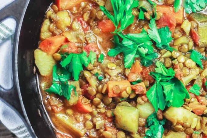 Chunky Vegan Lentil Soup Recipe | The Mediterranean Dish. Mediterranean style lentil soup with vegetables, warm spices, and fresh herbs. Anything but an ordinary lentil soup. Try this heart-warming, nutrition packed soup, and you'll be coming for more. Recipe via TheMediterraneanDish.com