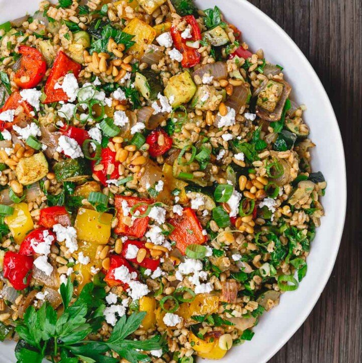 Mediterranean Roasted Vegetable Barley Recipe | The Mediterranean Dish. Easy, satisfying vegetarian barley recipe, prepared Mediterranean style. Tons of flavor from fresh herbs, spices and a simple zesty dressing. Perfect for meal prep. Recipe from TheMediterraneandish.com #barley #barleysalad #roastedvegetables #mediterraneandiet #mediterraneanfood