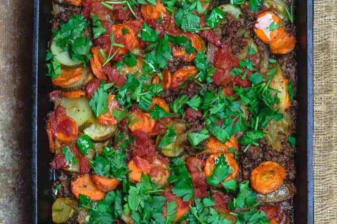 Mediterranean Style Zucchini Casserole | The Mediterranean Dish. Low carb zucchini casseroles with layers of zucchini, carrots, onions and a perfectly spiced meat sauce. Aromatics, warm Mediterranean spices, and fresh herbs make all the difference. See the full recipe on themediterraneandish.com #mediterraneandiet #zucchini #casserole #lowcarb #keto