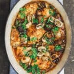 Wine braised chicken thighs with mushrooms and shallots in Dutch oven