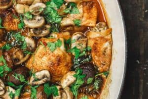 Wine Braised Chicken Thighs with a Mediterranean Rosemary spice rub, mushrooms, and shallots