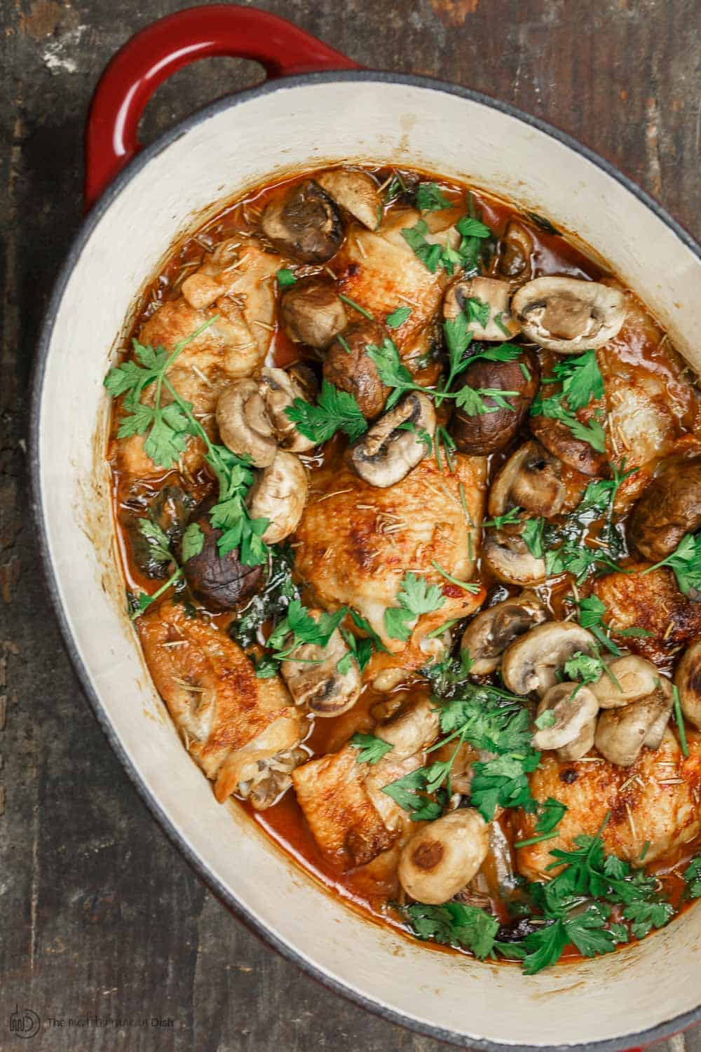 Wine-Braised Chicken Thighs, prepared Mediterranean-style with a rosemary spice rub, shallots, and mushrooms