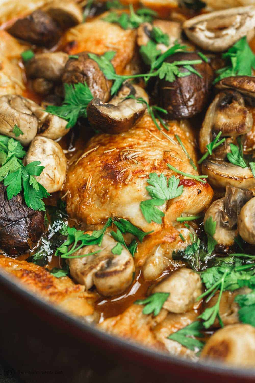 Side Angle Image. Wine braised chicken thighs