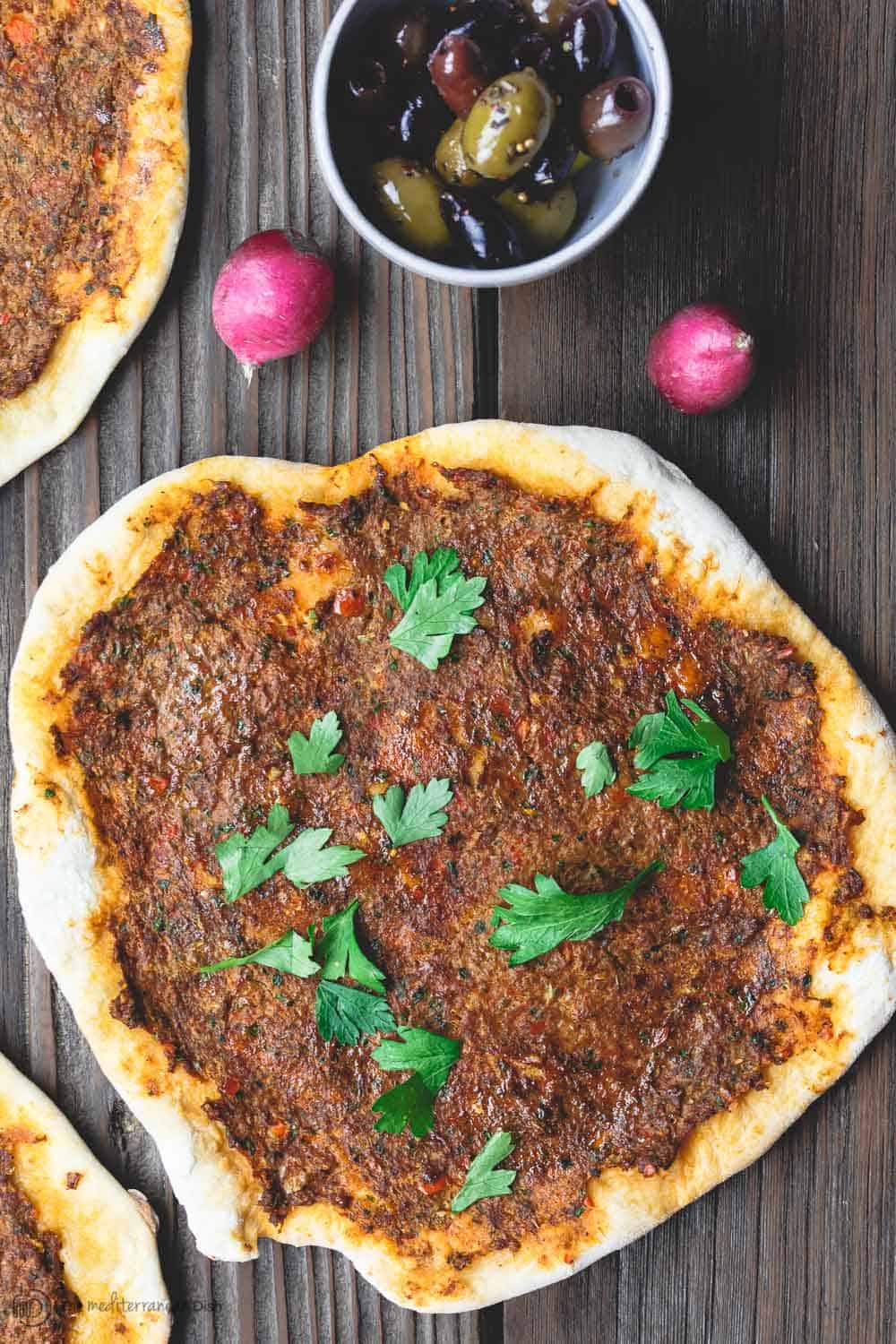 Turkish Lahmacun (Lamajoun). Flatbread with meat topping.