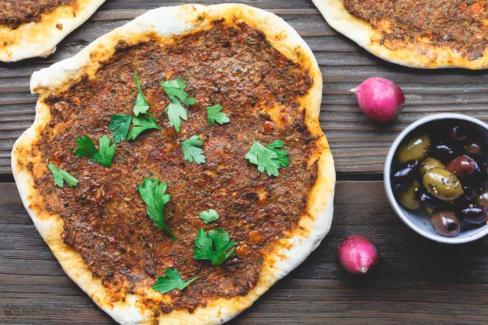 Turkish Lahamcun (Lahmajoun). Like a pizza with thin crust and a meat topping