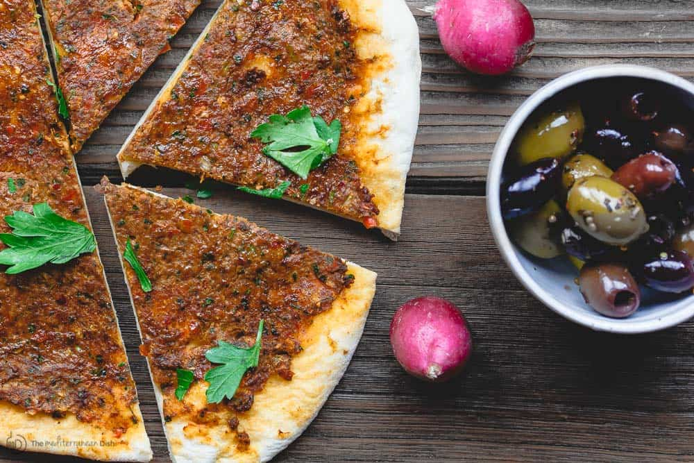 Sliced Turkish lahmacun (lahmajoun). To feed a crowd, slice it up and share with other mezze.