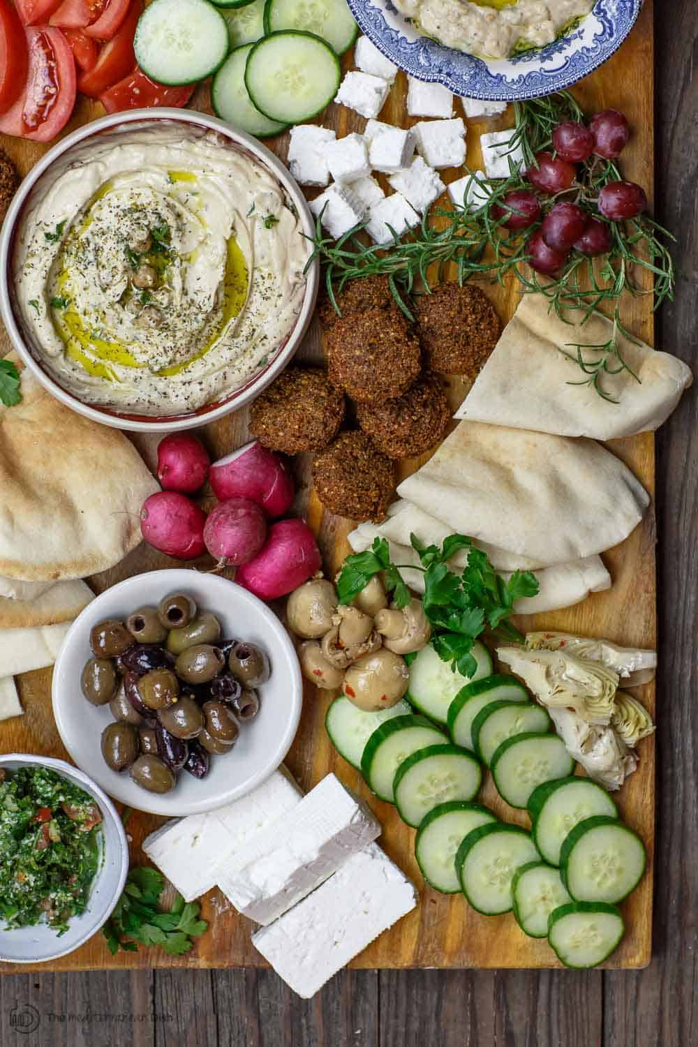 Mediterranean breakfast or brunch with falafel, hummus, baba ganoush,fresh vegetables and more