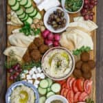 Ultimate Mediterranean Brunch Board with hummus, baba ganoush, falafel, tabouli and fresh vegetables