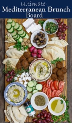 Ultimate Mediterranean Brunch Board with hummus, baba ganoush, falafel, tabouli and fresh vegetables