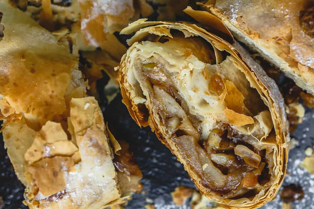 Side shot of phyllo apple strudel showing apple filling