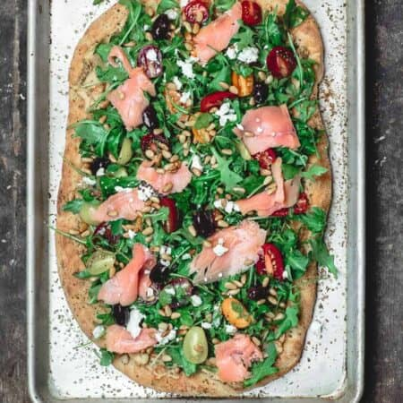Mediterranean Flatbread, topped with Arugula, Tomatoes, Smoked Salmon and More