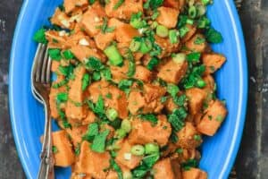 Simple Boiled Sweet Potatoes, tossed with fresh herbs, garlic, scallions and extra virgin olive oil