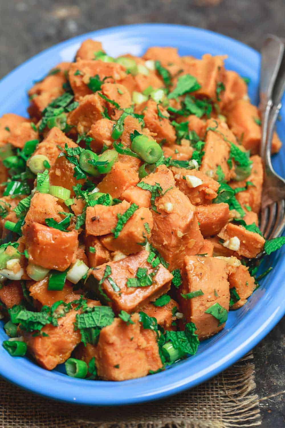 Simple sweet potato recipe with fresh herbs, garlic, scallions, and extra virgin olive oil