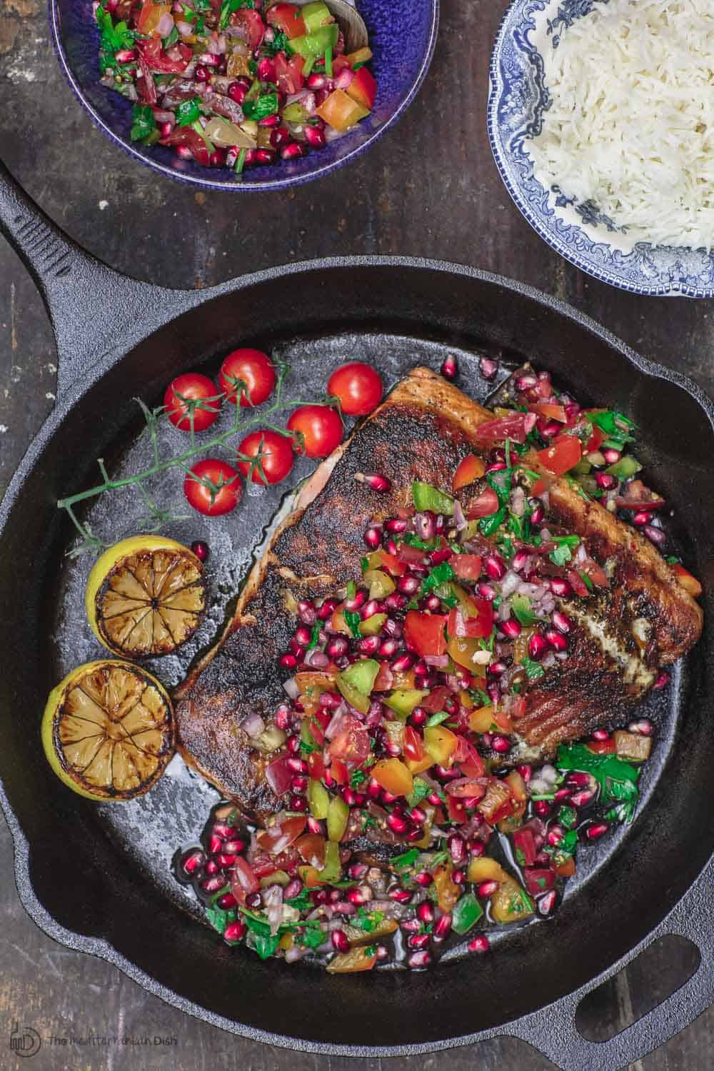 Mediterranean Blackened Salmon Served with Grilled Lemon Halves, Pomegranate Salsa and Rice