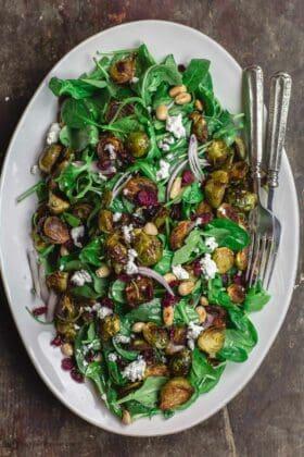 Mediterranean roasted brussels sprouts salad on large serving platter