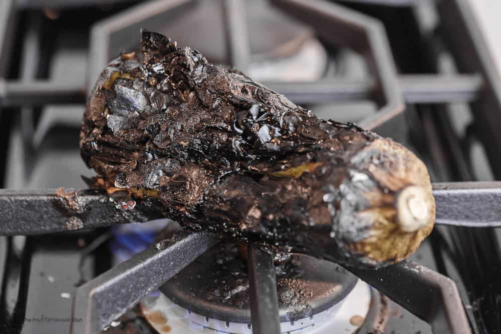 Eggplant cooked directly over a high-heat gas burner