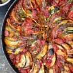 Briam. Traditional Greek Roasted Vegetables with potatoes, zucchini, red onions, tomatoes and extra virgin olive oil