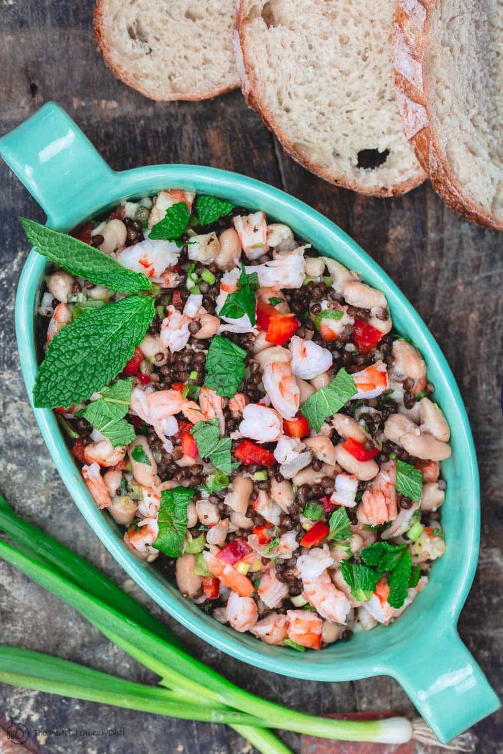White Bean Salad, Tuscan-Style with shrimp, lentils, fresh mint and red bell peppers. A side of crusty bread slices