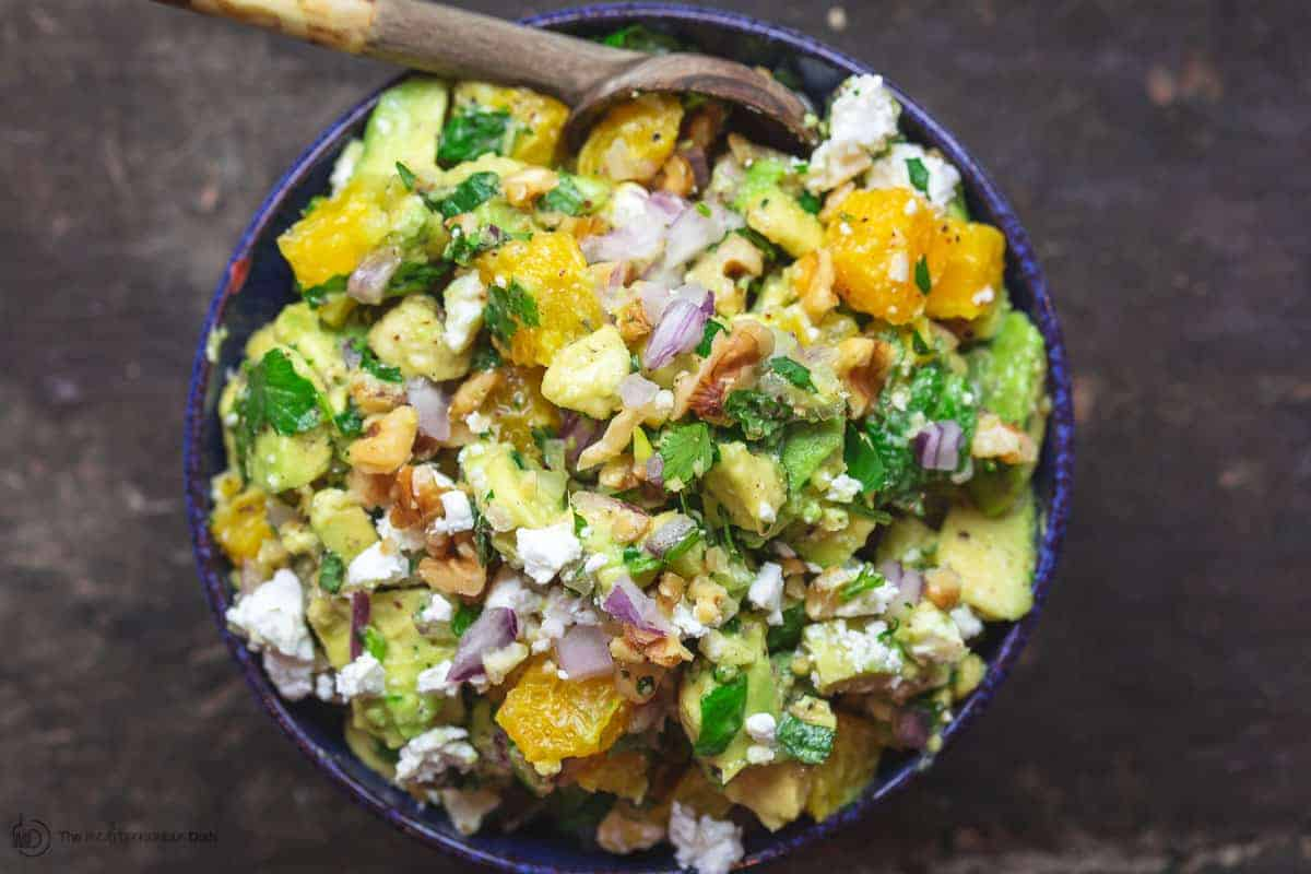 Citrus Avocado Dip in Serving Bowl with a small wooden spoon