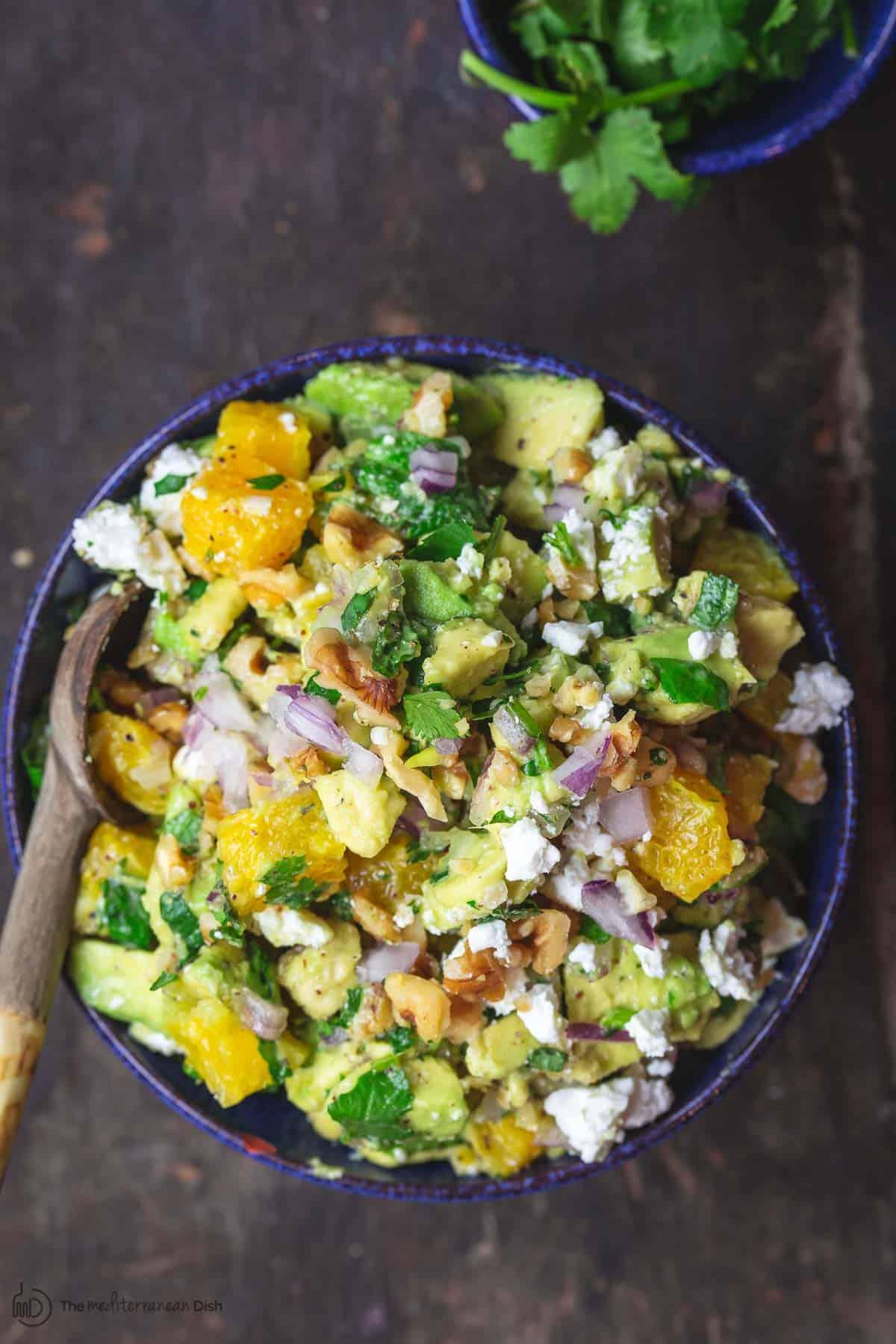 Avocado Dip with a Mediterranean twist including oranges, fresh herbs, feta and walnuts