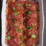 Greek Baked Meatballs with Red Sauce. Garnished with Parsley